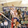 Kristyana Barnhill (10) and Hana Grebovic of Cousino with the winner. District host Cousino, defeats Sterling Heights 25-18, 25-14, 25-14 on November 1, 2016. (MIPrepZone photo gallery by George Spiteri)