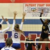 The Patriots Erin McArthur and Kelcey Heaney try to block Tatvana Hardwick (13) of Sterling Height's hit. District host Cousino, defeats Sterling Heights 25-18, 25-14, 25-14 on November 1, 2016. (MIPrepZone photo gallery by George Spiteri)