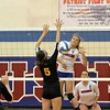 The Patriot's Jessica Tocco (8) hits a winner past Jessica Heilman of Sterling Heights. District host Cousino, defeats Sterling Heights 25-18, 25-14, 25-14 on November 1, 2016. (MIPrepZone photo gallery by George Spiteri)