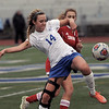 Taylor Handsall (14) of L'Anse Creuse battles for control of the ball with Kelcey Heaney (6) of Cousino during the match between Cousino and L'Anse Creuse on April 13, 2017. (MIPrepZone photo gallery by David Dalton)