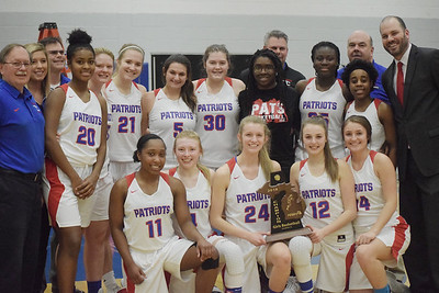 Cousino celebrates winning a third consecutive Class A district championship. Cousino defeated Sterling Heights 57-14 in a Class A girls district basketball championship game at Warren Woods-Tower on Friday, March 2.  THE MACOMB DAILY PHOTO GALLERY BY GEORGE POHLY