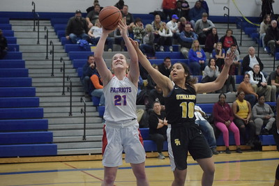 Cousino's Olivia Joliffe puts up a shot. Cousino defeated Sterling Heights 57-14 in a Class A girls district basketball championship game at Warren Woods-Tower on Friday, March 2.  THE MACOMB DAILY PHOTO GALLERY BY GEORGE POHLY