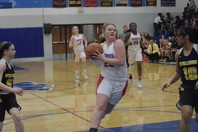 Cousino junior Kate McArthur takes the ball to the basket. Cousino defeated Sterling Heights 57-14 in a Class A girls district basketball championship game at Warren Woods-Tower on Friday, March 2.  THE MACOMB DAILY PHOTO GALLERY BY GEORGE POHLY