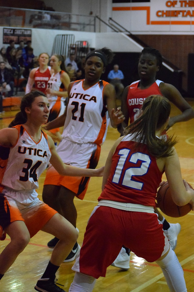 Cousino beat Utica, 54-45, in the opening round of the MAC Red/White Division Tournament on February 12, 2018. THE MACOMB DAILY PHOTO GALLERY BY CHUCK PLEINESS