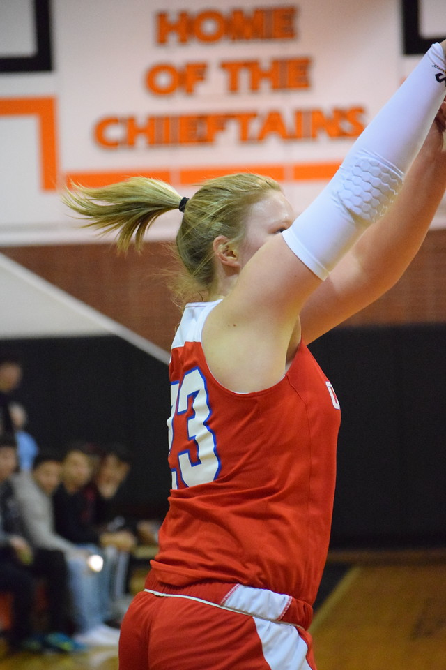 Cousino's Kate McArthur (23) puts up a 3-point attempt in the Patriots' 54-45 win over Utica on February 12, 2018. THE MACOMB DAILY PHOTO GALLERY BY CHUCK PLEINESS