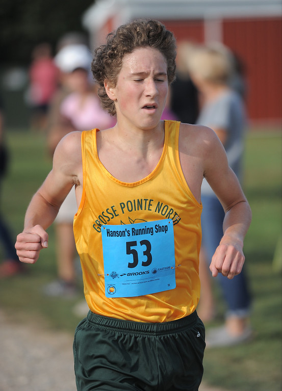 . William Hoffman of Grosse Pointe North comes in first during the cross country red division Jamboree at Westview Orchards in Romeo on September 12, 2017. THE MACOMB DAILY PHOTO GALLERY BY DAVID DALTON