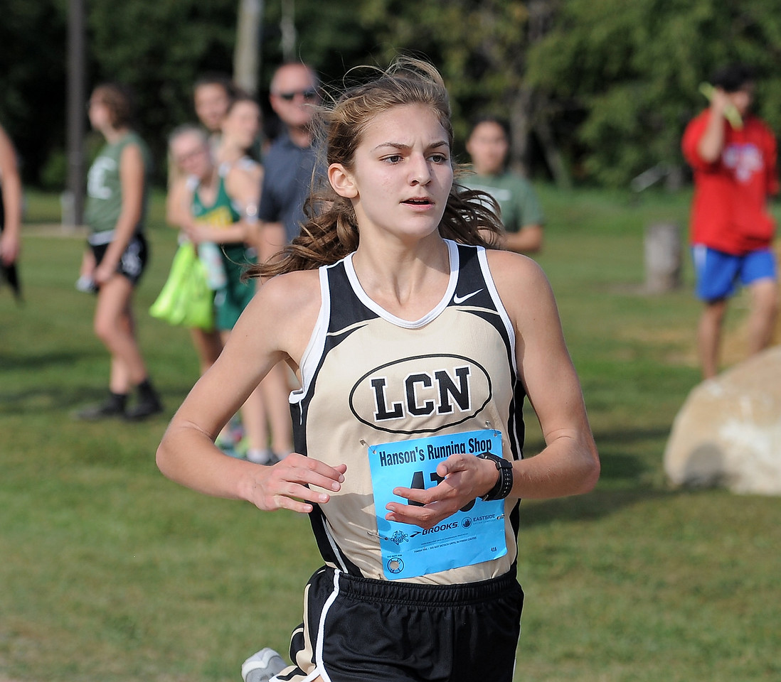 Karenna Duffey of L'Anse Creuse North comes in first during the MAC Red Division cross country jamboree at Westview Orchards in Romeo on September 12, 2017. THE MACOMB DAILY PHOTO GALLERY BY DAVID DALTON