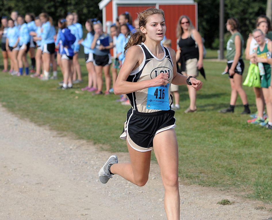 . Karenna Duffey of L�Anse Creuse North comes in first during the cross country red division Jamboree at Westview Orchards in Romeo on September 12, 2017. THE MACOMB DAILY PHOTO GALLERY BY DAVID DALTON