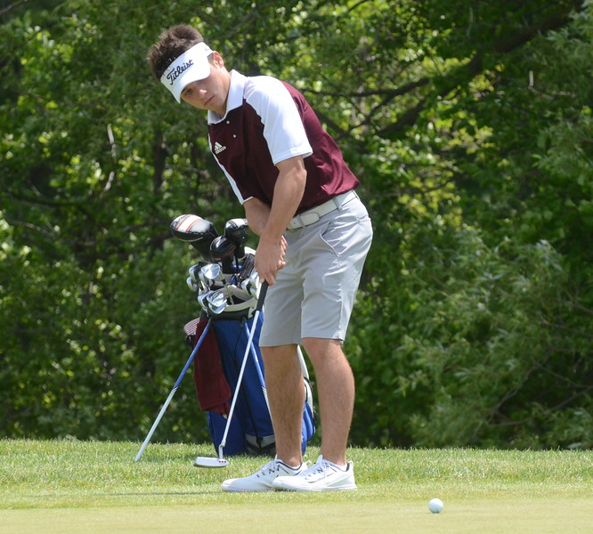 Ford senior Drew Tucci watches a putt during his round of 71 Wednesday at the Division 1 regional at Twin Lakes Golf Club in Oakland Township. Tucci was the medalist and led his team to a spot in the state finals next week. (MIPrepZone photo by Jason Schmitt)