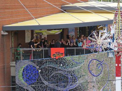 the Charm City Bronze Handbell Ensemble on the AVAM balcony