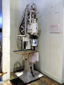 machine used for sanitary sealing of cans of oysters, February 24, 2018