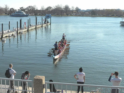 a Dragon Boat at the cherry blossom festival along the river