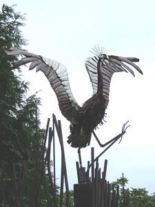 crane sculpture at shuttle drop-off gate