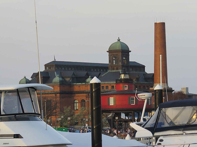 view looking across the harbor towards Seven Foot Knoll Lighthouse and the Public Works Museum building