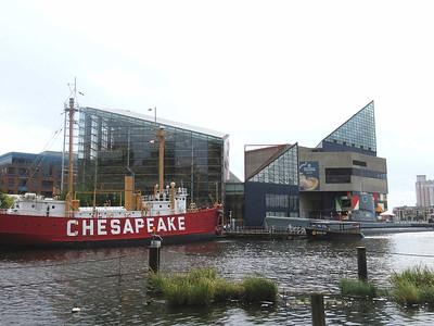 the National Aquarium along with historic ship and submarine, and a water taxi, as seen from the base of the Baltimore World Trade Center