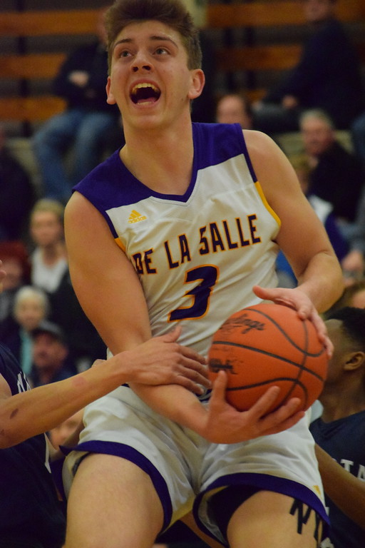 . De La Salle\'s Luke Pfromm (3) goes to the basket against Dakota in a Class A boys basketball regional championship on March 14, 2018. Pfromm led the Pilots with 16 points in the Pilots\' 56-51 win. DLS will meet U-D Jesuit on Tuesday in a Class A state quarterfinal. THE MACOMB DAILY PHOTO GALLERY BY CHUCK PLEINESS