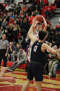 Chippewa Valley's Dennis Pozios shoots a jumper over Dakota's Brayan Sterkaj during the second quarter of their game on January 26, 2018. (Gallery by Kevin Lozon)