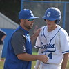 Eisenhower coach Jason Gendreau, who racked up his 200th career victory on Monday, talks with Andy Wolffis. His Eagles defeated Dakota 9-0. (MIPrepZone photo gallery by Jim Evans)