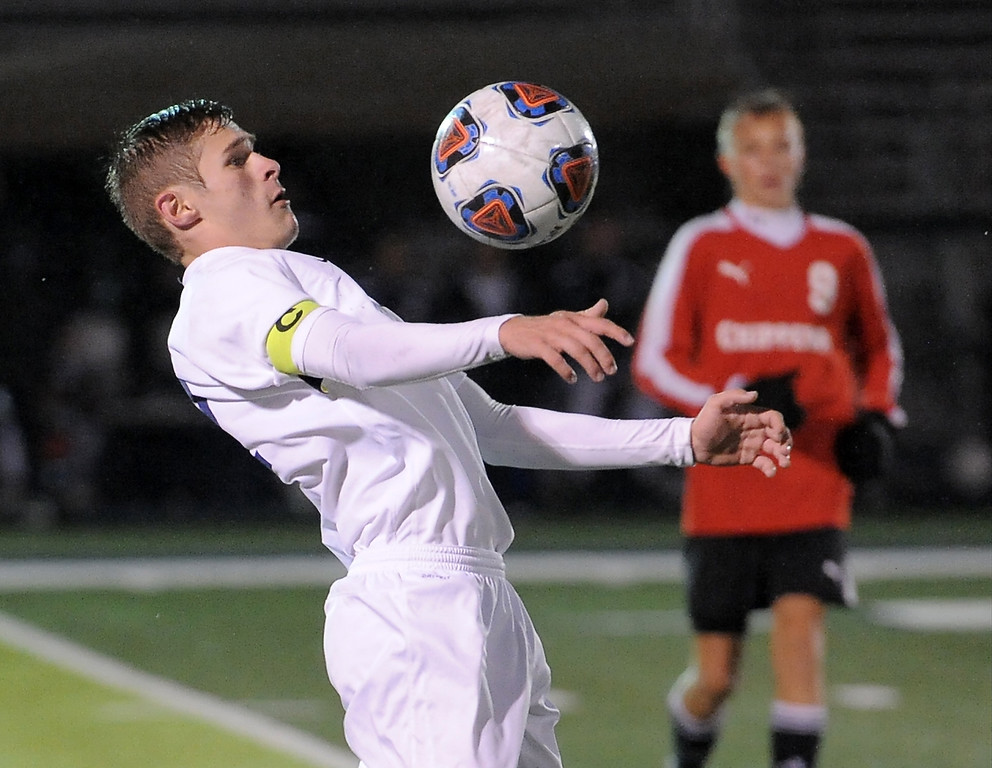 . Christian Cobbs (12) of Dakota heads the ball during the match between Dakota and Chippewa Valley on October 11, 2017. THE MACOMB DAILY PHOTO GALLERY BY DAVID DALTON