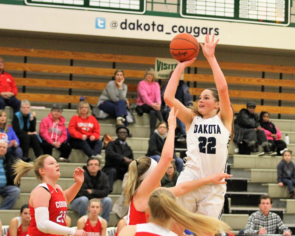 . The Cougar\'s Cameron Grant gets a shot off. Dakota defeats Cousino late 49-43 at Dakota on February 13, 2018. THE MACOMB DAILY PHOTO GALLERY BY GEORGE SPITERI