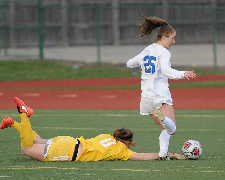 Lauren DeBeau (25) of Eisenhower kicks in a goal during the match between Dakota and Eisenhower on April 17, 2017.  (MIPrepZone photo gallery by David Dalton)