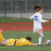 Lauren DeBeau (25) of Eisenhower kicks in a goal during the match between Dakota and Eisenhower on April 17, 2017.  (MIPrepZone photo gallery by David Dalton)