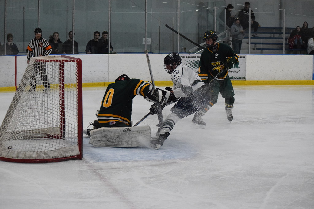 . Dakota\'s Brett Bush (22) scores on a breakaway against Grosse Pointe North goalie Kyle Losinski (30) in a non-conference boys hockey game on December 6, 2017. THE MACOMB DAILY PHOTO GALLERY BY CHUCK PLEINESS