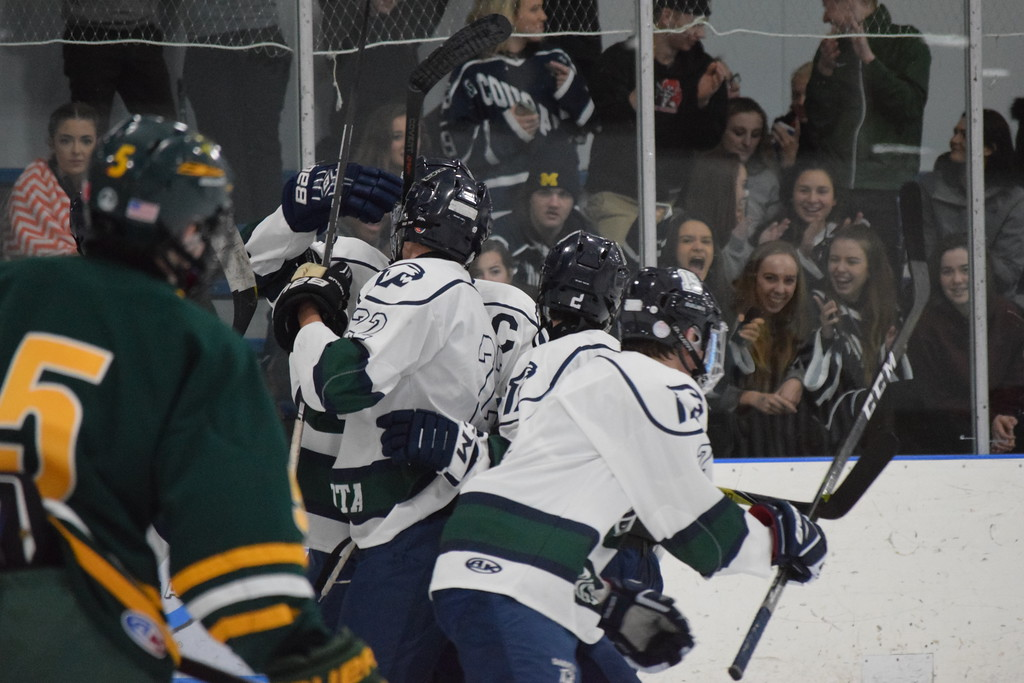 . Dakota celebrates after Brett Bush (22) scored on a breakaway against Grosse Pointe North to make it 2-0 Cougars in a non-conference boys hockey game on December 6, 2017. THE MACOMB DAILY PHOTO GALLERY BY CHUCK PLEINESS