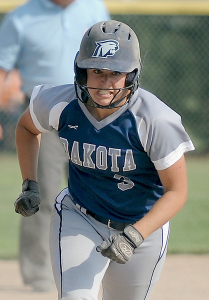 Kattie Popko (3) of Dakota runs in to home plate in the sixth inning . (MIPrepZone photo gallery by David Dalton)