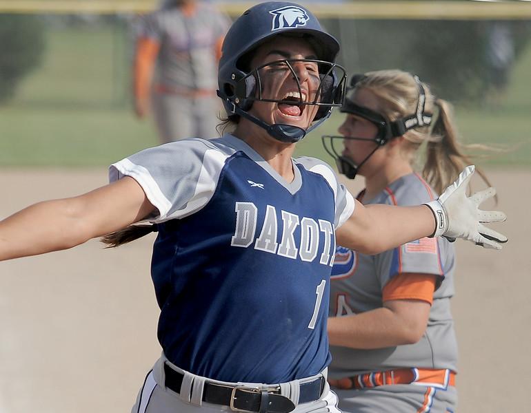 Jackie Popko (1) of Dakota runs in to home plate in the sixth inning to move Dakota ahead of Garden City 6-4. (MIPrepZone photo gallery by David Dalton)