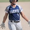 Jackie Popko (1) of Dakota runs in to home plate in the sixth inning to move Dakota ahead of Garden City 6-4. (MIPrepZone photo gallery by David Dalton)