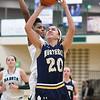 Jenna Koppinger (20) puts up a shot against Dakota Friday, Feb. 3.