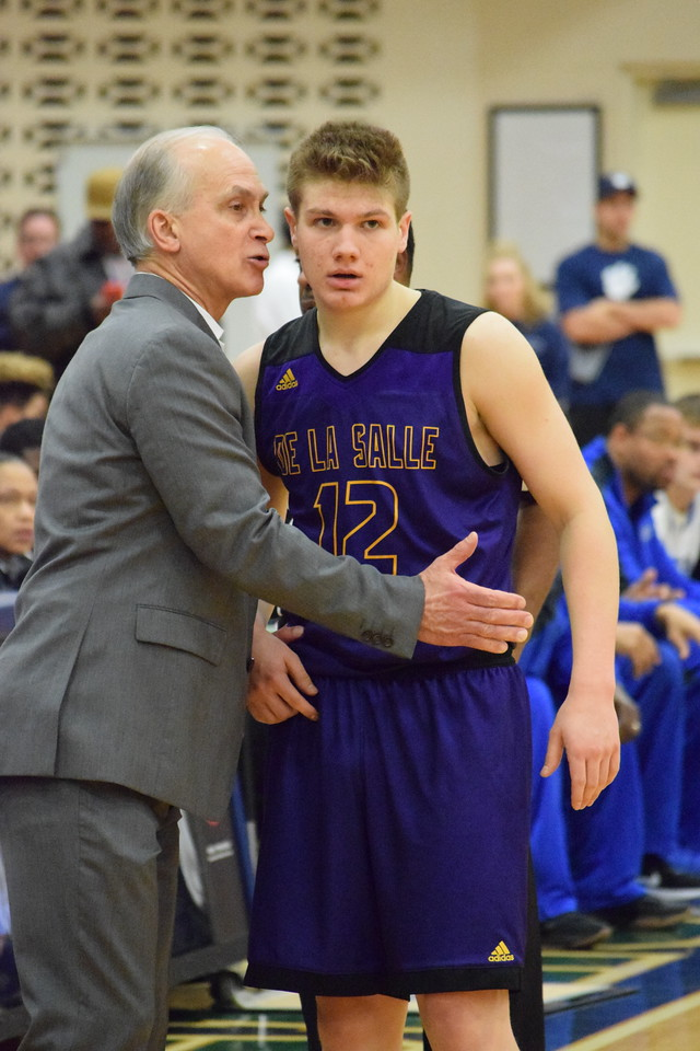 De La Salle coach Greg Esler talks to Easton Sikorski (12) during a break at Dakota on March 12, 2017. THE MACOMB DAILY PHOTO GALLERY BY CHUCK PLEINESS