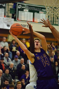 De La Salle's Jordan Winowiecki (14) is fouled on his way to the basket in the Pilots' 75-60 win over L'Anse Creuse in a Class A regional boys basketball semifinal at Dakota on March 12, 2017. THE MACOMB DAILY PHOTO GALLERY BY CHUCK PLEINESS