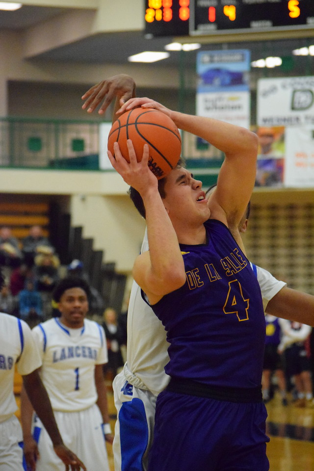 De La Salle's Kole Gjonaj (4) is fouled on his way to the basket in the Pilots' 75-60 win over L'Anse Creuse in a Class A regional boys basketball semifinal at Dakota on March 12, 2017. THE MACOMB DAILY PHOTO GALLERY BY CHUCK PLEINESS