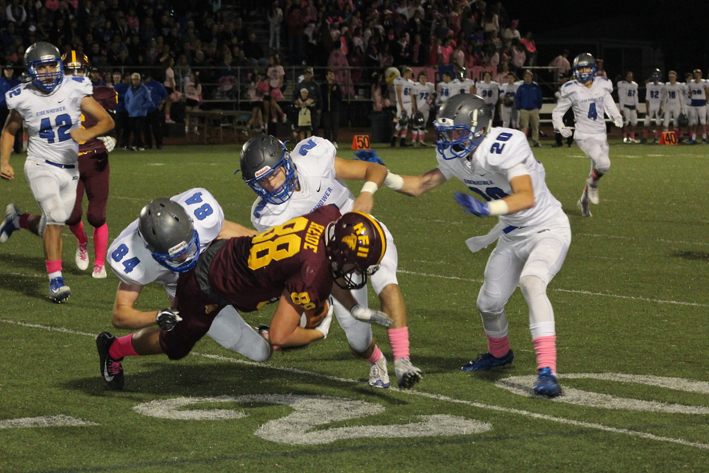 . Eisenhower\'s Massimo D\'Aristotile (84), Alex Decker (2) and Ian Kennelly (20 ) converge to tackle Ford II\'s Luke Heide during their MAC crossover game on Oct. 20, 2017. (Photo gallery by Kevin Lozon)