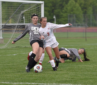 Emma Campbell (22) of Eisenhower battles for control of the ball with Jessica Schneider (3) of Anchor Bay on May 21, 2018. MACOMB DAILY PHOTO GALLERY BY DAVID DALTON