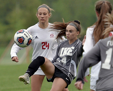 Meike Ingles (14) of Eisenhower battles for control of the ball with Mackenzie Rahn (24) of Anchor Bay on May 21, 2018. MACOMB DAILY PHOTO GALLERY BY DAVID DALTON