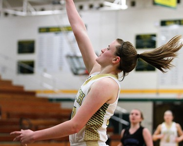 Julia Ayrault of Grosse Pointe North watches her 3 point shot go down in the 3rd quarter. Eisenhower traveled to Grosse Pointe North for a MAC Red girls basketball game on January 8, 2019. Digital First Media photo gallery by George Spiteri.