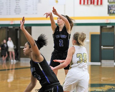 Ikes Lauren Debeau (2) gets off a shot. Eisenhower traveled to Grosse Pointe North for a MAC Red girls basketball game on January 8, 2019. Digital First Media photo gallery by George Spiteri.