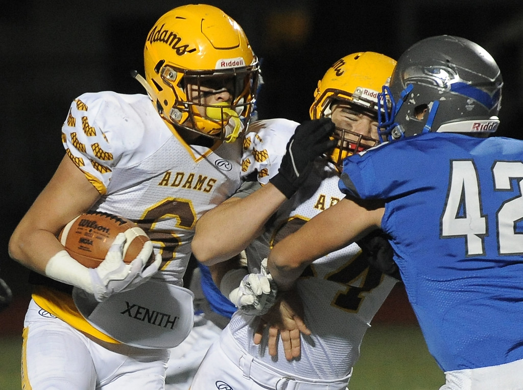 . Chase Kareta (6) of Rochester Adams carries the ball during a first quarter play during the match between Adams and Eisenhowr on November 3, 2017. THE MACOMB DAILY PHOTO GALLERY BY DAVID DALTON