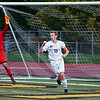 Eagles' Captain Chris DeClercq (15) kicks home his second goal of the first half past Keeper Robert Gjelaj (30).Eisenhower and Romeo matched up Wednesday night at L'Anse Creuse North High School for their second round district playoff game. Ike won 4-0. (MIPrepZone photo gallery by Jon Kohlmann).