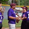 Ford coach Matt Joseph meets his team after a good half inning. (MIPrepZone photo gallery by Chuck Pleiness).