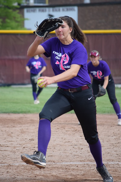 Ford's Emily Karas gave up three hits and struck out two to lead the Falcons in the opener in a doubleheader with Regina. (MIPrepZone photo gallery by Chuck Pleiness).