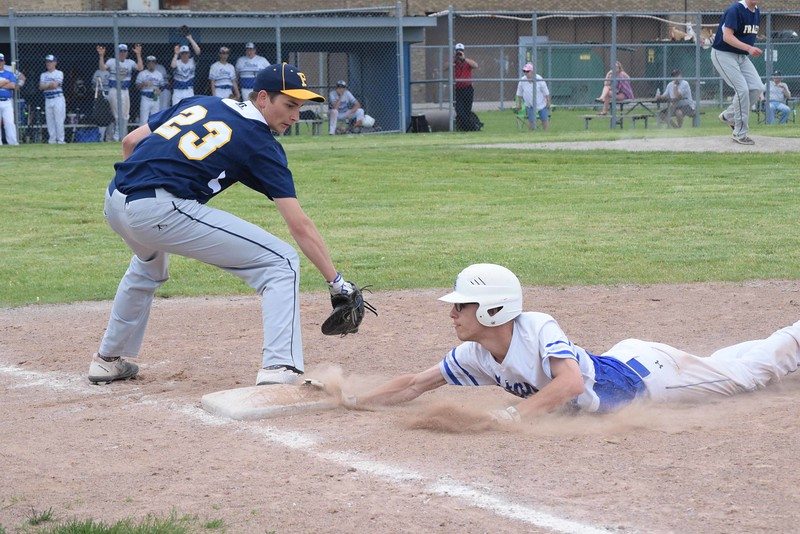 GEORGE POHLY -- THE MACOMB DAILY<br /> Nick Kay of Warren Woods-Tower dives safely back to first base as Fraser's Nick Binkowski reaches to make a tag in the second inning of a MAC Gold game. Kay scored later in the inning, but Fraser won 24-13. Fraser defeated Warren Woods-Tower 24-13 to clinch the MAC Gold championship on May 17, 2017. (MIPrepZone photo gallery by George Pohly)