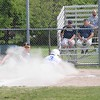GEORGE POHLY -- THE MACOMB DAILY<br /> Nick Kay of Warren Woods-Tower scores from third base on a wild pitch as Fraser pitcher Noah Walker covers in the bottom of the first inning of a MAC Gold Division game. Fraser defeated Warren Woods-Tower 24-13 to clinch the MAC Gold championship on May 17, 2017. (MIPrepZone photo gallery by George Pohly)
