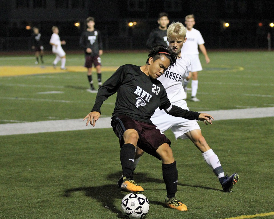 . JB Braganza (23) of Ford settles the ball while being pressured by Ethan Werner of Fraser. Ford defeated Fraser 1-0 in a MAC Red Division contest at Fraser on Monday, October 9, 2017. Macomb Daily photo gallery by George Spiteri.