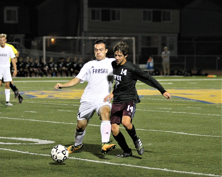 Fraser's Vincent Castillo and Ford's Mateo Gjurashaj during 1st half play. Ford defeated Fraser 1-0 in a MAC Red Division contest at Fraser on Monday, October 9, 2017. Macomb Daily photo gallery by George Spiteri.