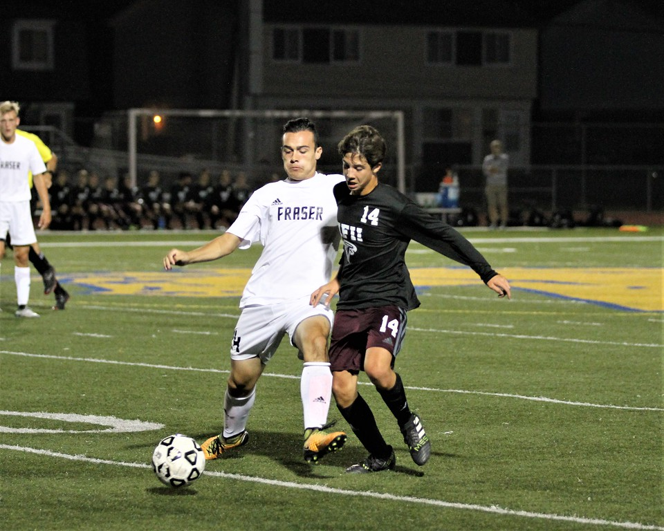 . Fraser\'s Vincent Castillo and Ford\'s Mateo Gjurashaj during 1st half play. Ford defeated Fraser 1-0 in a MAC Red Division contest at Fraser on Monday, October 9, 2017. Macomb Daily photo gallery by George Spiteri.
