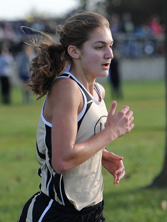 . Karenna Duffey of L�Anse Creuse North comes in first during the cross country meet at Lake St. Clair Metropark on October 21, 2017.  THE MACOMB DAILY PHOTO GALLERY BY DAVID DALTON